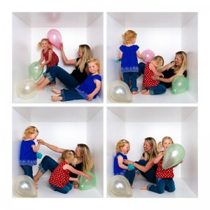 mother and daughters palying with balloons