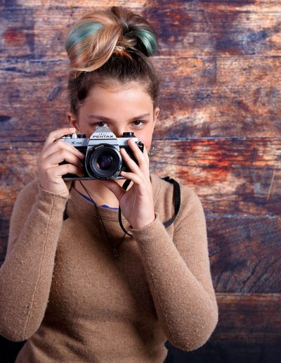 tween girl posing with camera